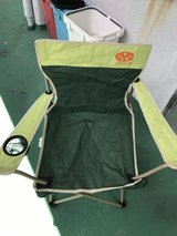 green camping chair in Okinawa, Japan
