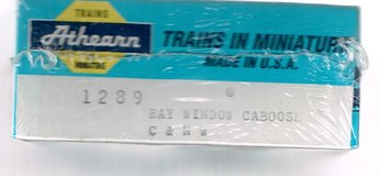 HO Scale Athearn KIT for a Chicago & Northwestern Bay Window Caboose Numbered 11135 in Joliet, Illinois