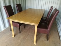 Dining Table with four leather high back chairs in Lakenheath, UK