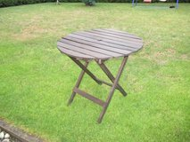 round wooden lawn table in Ramstein, Germany
