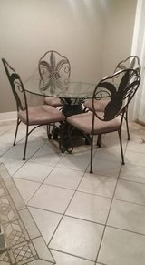 Pineapple Glass top table with 4 chairs & matching Bakers Rack in Pensacola, Florida
