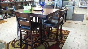 Pub style dining table and chairs in Warner Robins, Georgia