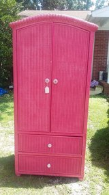 Pink wicker type armoire in Camp Lejeune, North Carolina