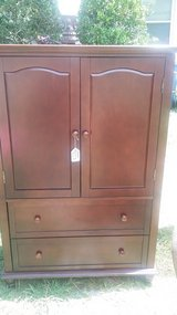 Dark brown Sears armoire in Camp Lejeune, North Carolina