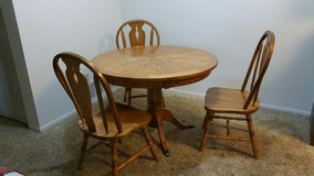 Wooden table with three chairs in Colorado Springs, Colorado