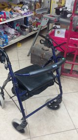 Walker with seat.  Works great in 29 Palms, California