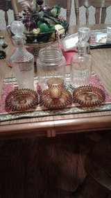 3 candle holders, 2 decanters, 1 old jar in DeRidder, Louisiana