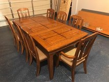 Solid wood dining table and chairs in Fort Carson, Colorado