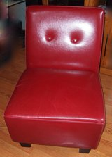 Dark red faux leather accent chair in Elgin, Illinois