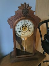 Antique gingerbread clock with key in Glendale Heights, Illinois