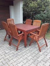 Extendable wood table with 8 chairs and seat cushions in Stuttgart, GE