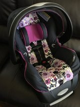 Like New! Purple Floral Evenflo Infant Car seat in New Lenox, Illinois