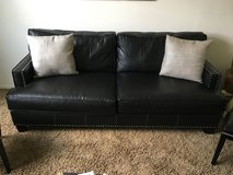 Black leather sofa and chair set in Aurora, Illinois