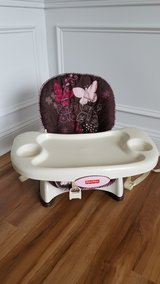 pink butterfly buster chair with tray. in Fort Bragg, North Carolina