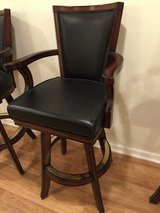Black leather swivel bar stools with arms in Joliet, Illinois