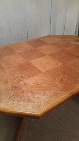 Solid Oak Extending Dining Table Used -4 seats table can extend to 6 seating table, as needed in Naperville, Illinois