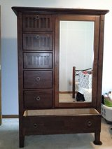 Tall dark wood dresser in Bolingbrook, Illinois