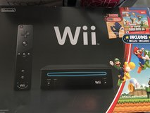 Black Wii console and games in San Clemente, California