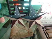 pair of tin patriotic planter stars in Wilmington, North Carolina