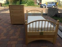 Twin bed and dresser in Ramstein, Germany