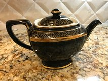 Beautiful Black and Gold Tea Pot in Spring, Texas