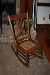 Vintage Wooden Rocking Chair with Cane Bottom in Camp Lejeune, North Carolina