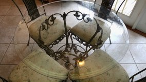 Iron and Glass Round Dining table with Four Chairs in Jacksonville, Florida