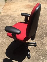 Red straight back swivel office chair in Gainesville, Georgia