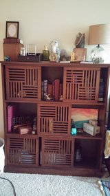 Dark wooden bookcase Shelf with Oriental Sliding Doors. in Lockport, Illinois