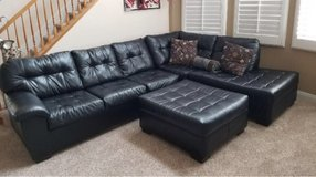 black sectional couch with ottoman in Nellis AFB, Nevada