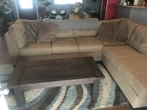 2 piece sectional couch with coffee table & area rug in 29 Palms, California