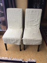 2 faux leather chairs with covers in Ramstein, Germany