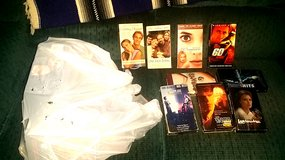 Bag full of old VHS tapes, mostly commercially produced in Conroe, Texas