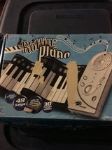 Rubber floor table top piano in Chicago, Illinois