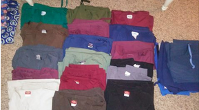 16 pairs of Unisex scrubs and 13 misc pieces. Most pants tailored to fit a 5'6 ps in Travis AFB, California