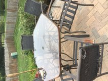Glass outdoor patio table with 6 chairs in Yorkville, Illinois