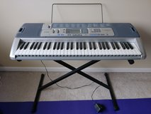 CASIO keyboard with adjustable stand + music sheet holder + Power Adapter in Naperville, Illinois