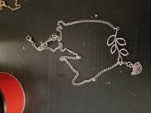 Silver bird and branch necklace in Hinesville, Georgia