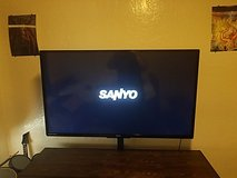 black Sanyo flat screen tv with tv stand in Lawton, Oklahoma