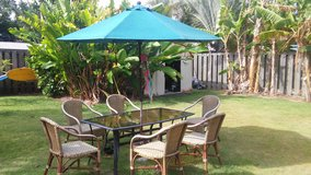 Outdoor table and 6 chairs plus umbrella in Kaneohe Bay, Hawaii
