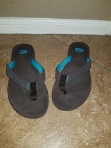 Brown and teal soft flip flops in Kingwood, Texas