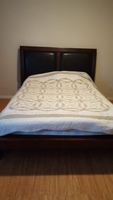 mattress and wood frame set in Katy, Texas