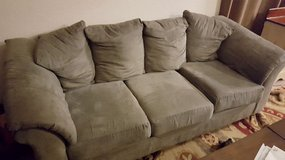 Grey microfiber couch, chair, and ottoman in San Diego, California