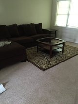 Brown sectional in Goldsboro, North Carolina