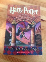 Harry Potter and The Sorcerer's Stone (the first book of the Harry Potter series) by J. K Rowling in Manhattan, Kansas