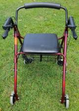 Lumex Walker 4 Wheel Rollator, Red; with breaks, seat, & basket in Camp Lejeune, North Carolina
