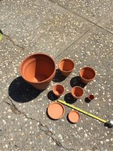 8 piece lot of Terra Cotta pots and saucers in Travis AFB, California