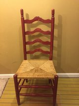 red wooden chair with straw seat in Bolling AFB, DC