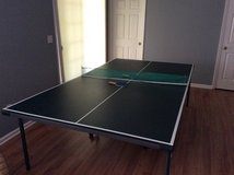 Ping Pong Table with paddles in West Orange, New Jersey