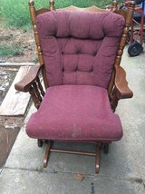Brown and maroon padded armchair glider in Fort Campbell, Kentucky